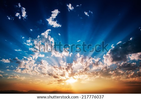Awesome sunrise with clouds that emit light - stock photo
