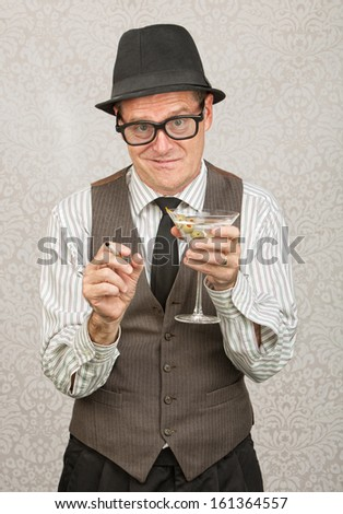 Awkward tipsy business man with cigarette and martini - stock photo