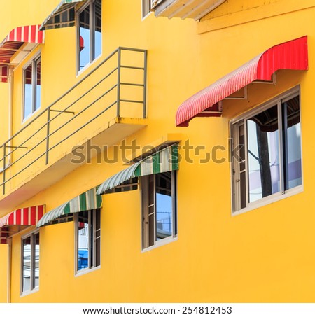 Awning above the windows on building wall - stock photo