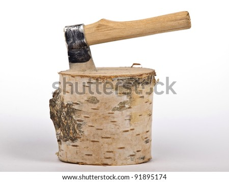 ax with handle stack in the chopped wood - stock photo