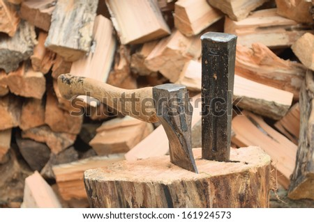 Axe and wedge for splitting wood  - stock photo