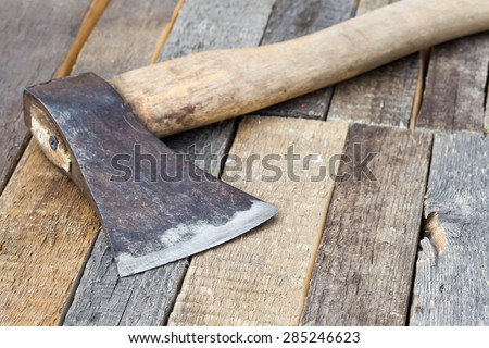 Axe on a wooden background, closeup - stock photo