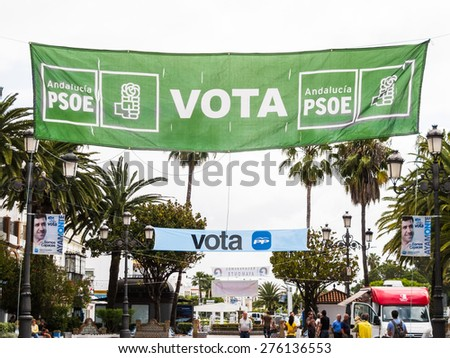 AYAMONTE, SPAIN - MAY 8 2015. Political banners hang throughout this southern spanish coastal town in preperation for the 2015 municipal elections which will be held in Spain on Sunday, 24 May 2015. - stock photo