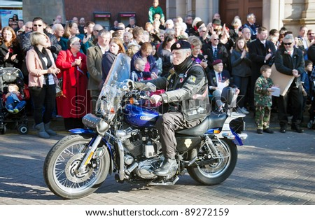 AYLESBURY, ENGLAND - NOVEMBER 13: A military veteran of the Royal British Legion attends the Armistice Day ceremony on his motorcycle as part of the military parade on November 13, 2011 in Aylesbury - stock photo