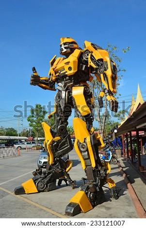 AYUTTAYA,THAILAND - NOVEMBER 08, 2014 : The Replica of Bumblebee robot made from iron part of a Car display at Thung Bua Chom floating market - stock photo