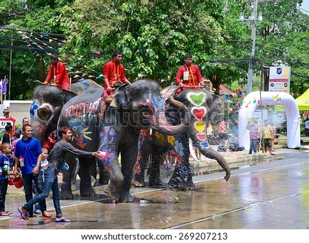 Ayutthaya-13 April 2015-Group of Thai elephants are playing with people on street during Songkran Thailand's New Year festival.  - stock photo