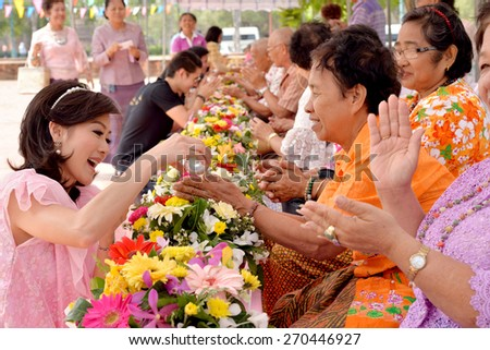 Ayutthaya, THAILAND - APRIL 13, 2015 : Unidentified Thai people celebrate Songkran festival by giving garlands to their seniors and asked for blessings in Ayutthaya, THAILAND  - stock photo