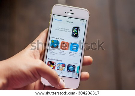 AYUTTHAYA, THAILAND - AUGUST 3, 2015: iPhone5s with featured mobile games apps in App Store collection. App Store is a digital distribution service for mobile apps, developed by Apple Inc. - stock photo