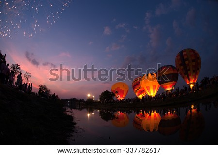 AYUTTHAYA , THAILAND - DECEMBER 5, 2009 : Hot air balloon show at night in Thailand International Balloon Festival 2009 in Ayutthaya Historical Park of Thailand , Ayutthaya old city,Thailand. - stock photo