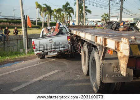 AYUTTHAYA, THAILAND - JULY 06: Rescue forces in a deadly car accident scene on July 06 2014. Road accident coupe gray hit the SUV car on the freeway in rush hour. - stock photo