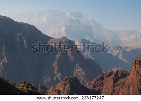 AZ-Grand Canyon-S Rim-S Kaibab Trail.  The smoke from a controlled burn has created a haze over the beautiful cliffs on the S Rim trails.   - stock photo