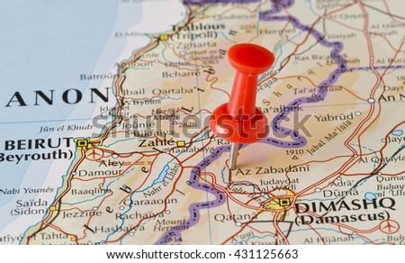 Az-Zabadani marked on map with red pushpin. Selective focus on the word Az-Zabadani and the pushpin. Pin is in an angle. Midground is sharp while foreground and background is blurry. - stock photo