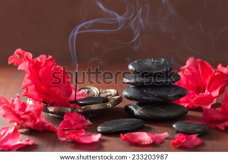 azalea flowers black massage stones incense sticks for aromatherapy spa - stock photo