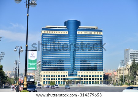 AZERBAIJAN, BAKU, JUNE 16, 2014: Freedom Square on the background of the Hilton Hotel - stock photo