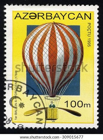 AZERBAIJAN- CIRCA 1995: A stamp printed in Azerbaijan shows balloon in white and red stripes, circa 1995 - stock photo