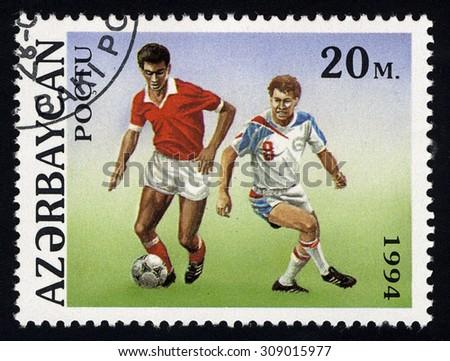 AZERBAIJAN - CIRCA 1994: A stamp printed in Azerbaijan shows soccer, circa 1994 - stock photo