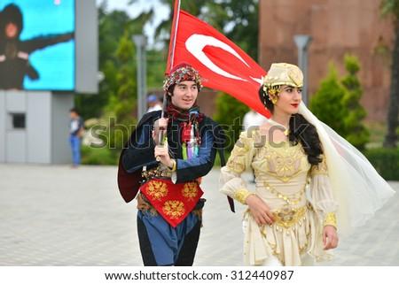 AZERBAIJAN, MASALLI, JUNE 13, 2014: Azerbaijan international folk festival 2014 in Masalli city. Turkish delegation carries flag. - stock photo