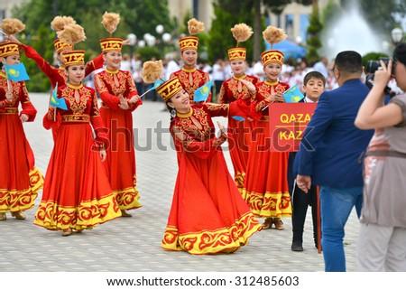 AZERBAIJAN, MASALLI, JUNE 13, 2014: Azerbaijan international folk festival 2014 in Masalli city. A Group of Kazakhstan folk dancers. - stock photo