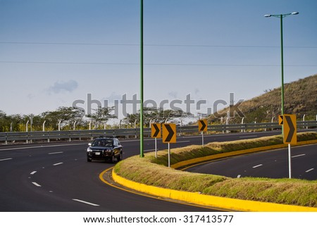 AZOGUES, ECUADOR - MARCH 8, 2013: Modern and well maintained highway in Ecuador - stock photo