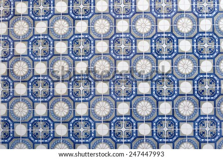 Azulejo is a form of Portuguese or Spanish painted, tin-glazed, ceramic tilework  - stock photo
