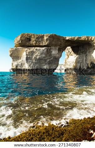 Azure Window, famous stone arch of Gozo island in the sun in summer, Malta Dwejra - stock photo