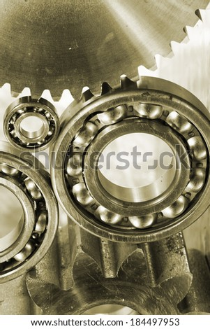 b all-bearings, gears and cogs in a bronze toning concept - stock photo