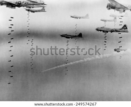 B-17 Flying Fortresses of U.S. 8th Air Force bombing Dresden in April 17, 1945. A disabled plane leaves a smoke trail as it descends in the background. April 17, 1945. - stock photo