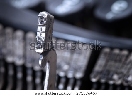 B hammer for writing with an old manual typewriter - cold blue filter - stock photo