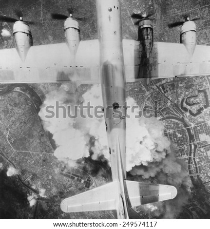 B-29 Superfortress over Osaka, Japan on June 1, 1945. Thousands of incendiary bombs were dropped into the city's industrial area during the last year of World War 2. - stock photo
