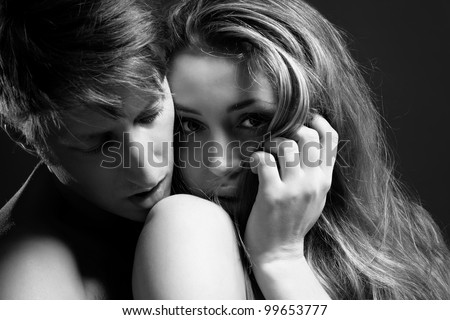 B&W close up portrait of a passionate couple - stock photo