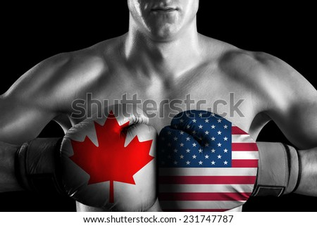 B&W fighter with Canada and USA color gloves - stock photo