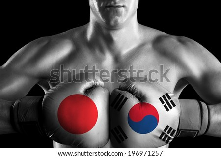 B&W fighter with Japan and South Korea color gloves - stock photo