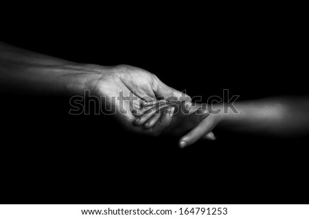 B/W Hands mother and baby close-up - stock photo