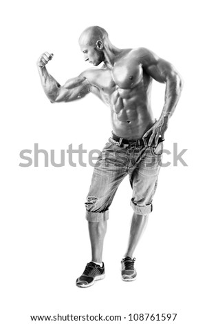 B&W Muscled male model posing in studio at white background - stock photo