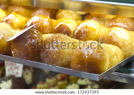 Baba, typical italian cake from the city of Naples - stock photo