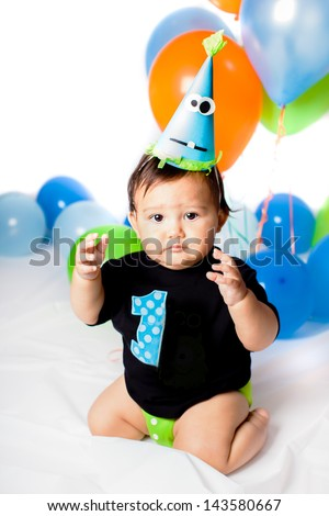 Babies' First Birthday One year old with colorful balloons - stock photo
