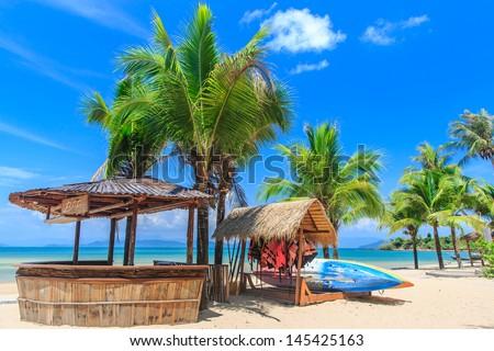 Baboo bar on white sand beach at tropical island, Koh Payam, Thailand - stock photo