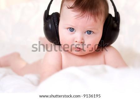 baby and  earphones - stock photo