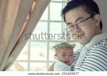 Baby and father happiness in studio home. - stock photo