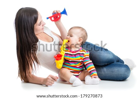 baby and mom play musical toys - stock photo