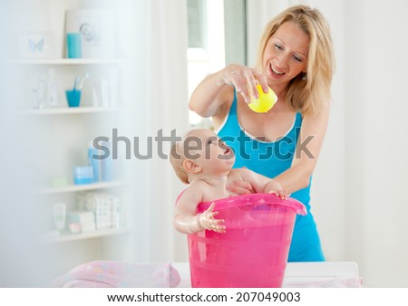 baby bathing - stock photo