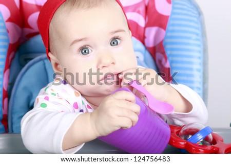 Baby bite spoon - stock photo