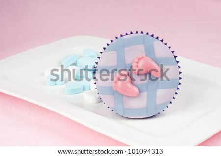 Baby blue and pink cupcake fot babyshower - stock photo