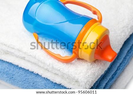 Baby blue bottle on a white background - stock photo