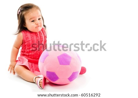 Baby bored with the plush doll on white background . - stock photo