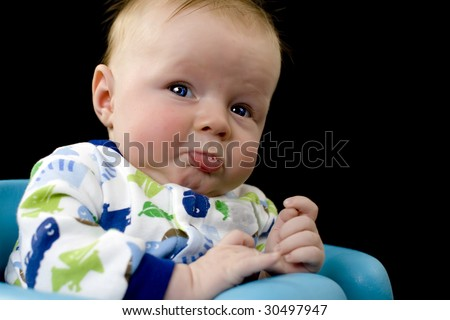 Baby boy about to cry with lower lip sticking out and pouting - stock photo