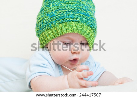 Baby boy clothes knitted cap warm - stock photo