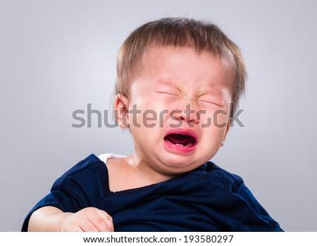Baby boy crying - stock photo