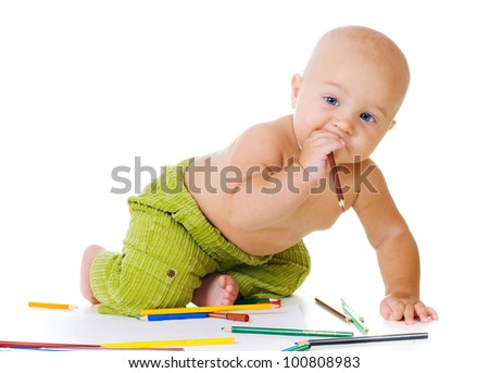 baby boy drawling with color pencils. On white background - stock photo