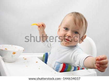 Baby Boy Eating - stock photo